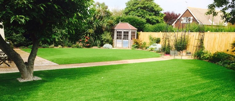 Link to page Artificial Grass with Dog and Boy