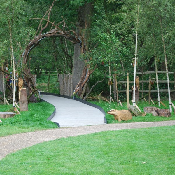 Entrance way through huge metal arches to the wildness garden at Chestnut Tree Hospice