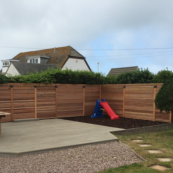 Millboard Composite Decks with Play Area and Cedar Trellis