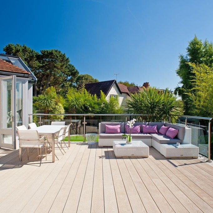 Large sunny deck area made in Millboard Composite Deck Boards