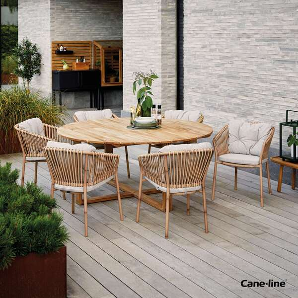 Cane-line large table and chair set by Garden House Design