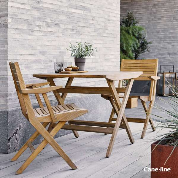 Cane-line table and chairs by Garden House Design
