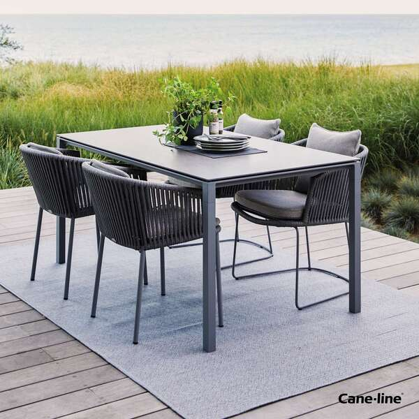 Cane-line table and chair set by Garden House Design