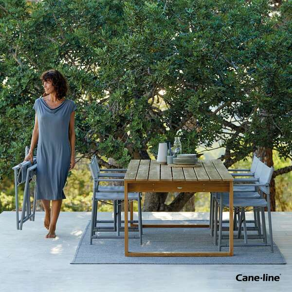 Cane-line dining table set with chairs by Garden House Design