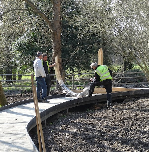 Putting up moon gates on the woodland walk at Chestnut Tree House