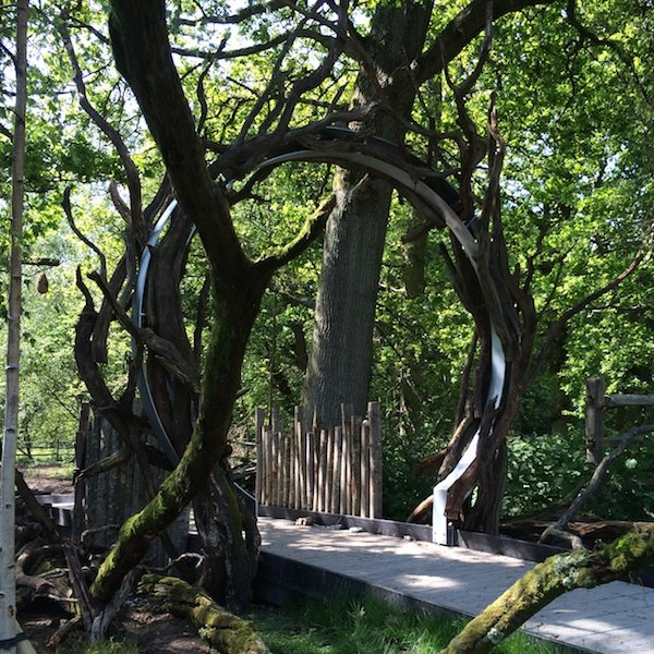 A beautiful metal moon gate along the woodland walk at Chestnut Tree House
