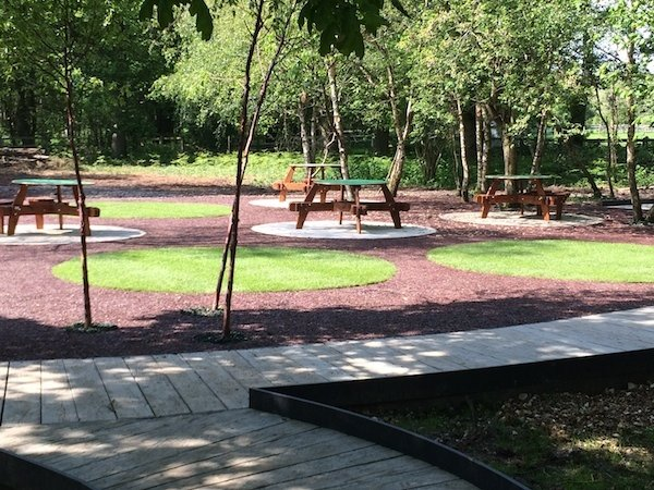 The finished rubber bark play and picnic area at Chestnut Tree House