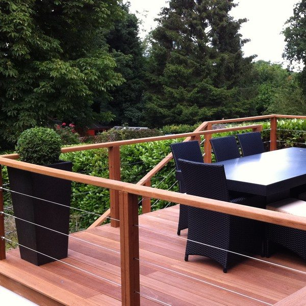 A wooden decked are with stainless steel balustrades and modern planters