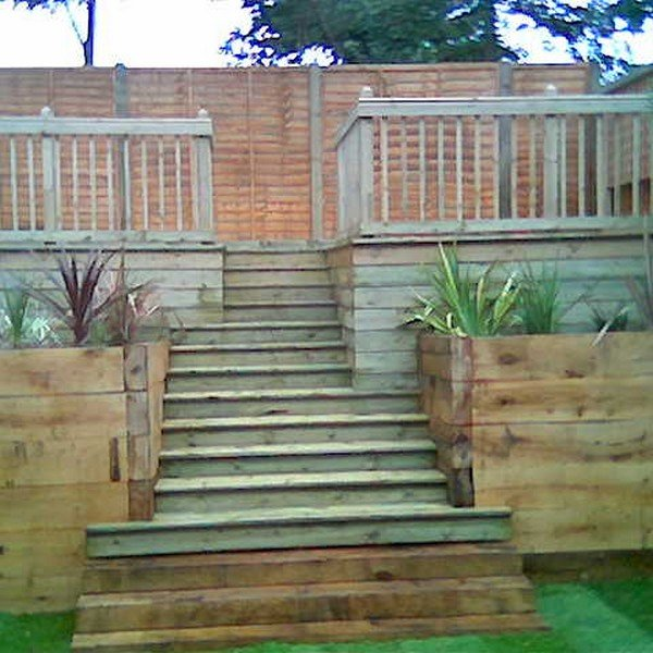Wooden steps leading to a raised deck