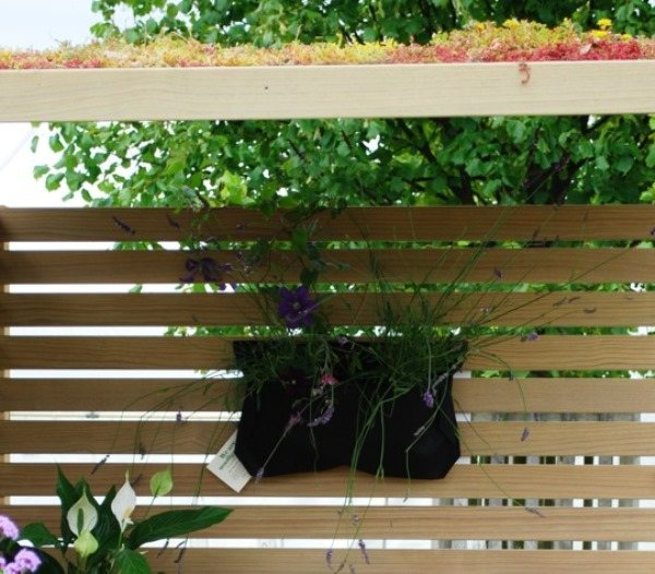 Create instant living art with our range of Woolly Pockets and Green Roofs on bespoke trellis walls