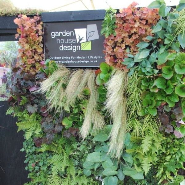 Our company logo surrounded by a vast array of planters in Woolly Pockets