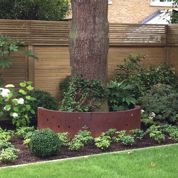 corten steel circle surround to add feature to this garden bed