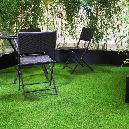 Artificial grass seating area with bamboos used as garden dividers