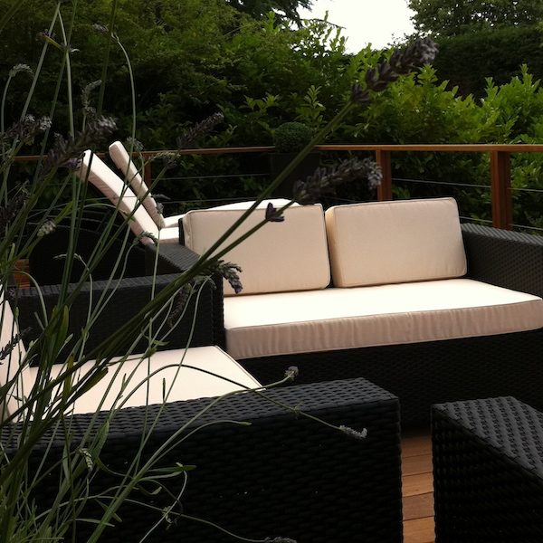 Wicker outdoor furniture and sun loungers to create a laid back atmosphere
