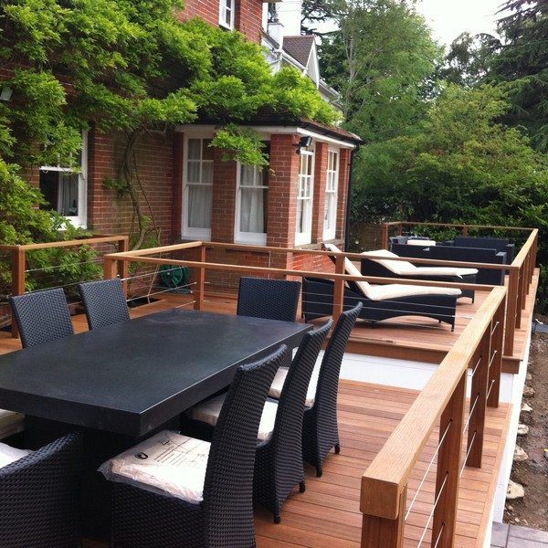 Outdoor dining and relaxation area on raised decking with balustrades