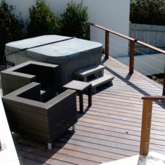 Raised decking with covered hot tub and garden furniture