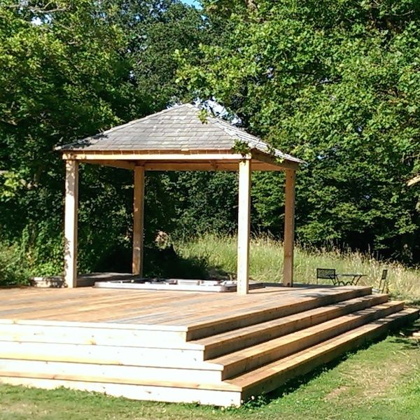Bespoke covered hot tub sunken into raised decking platform built by Garden House Design