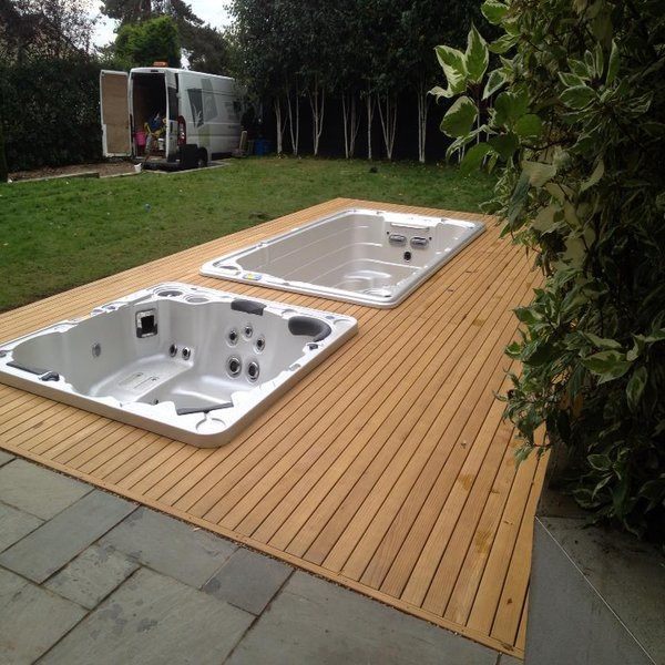 Sunken Hydropool swim spa and hot tub surrounded by wooden Verda decking