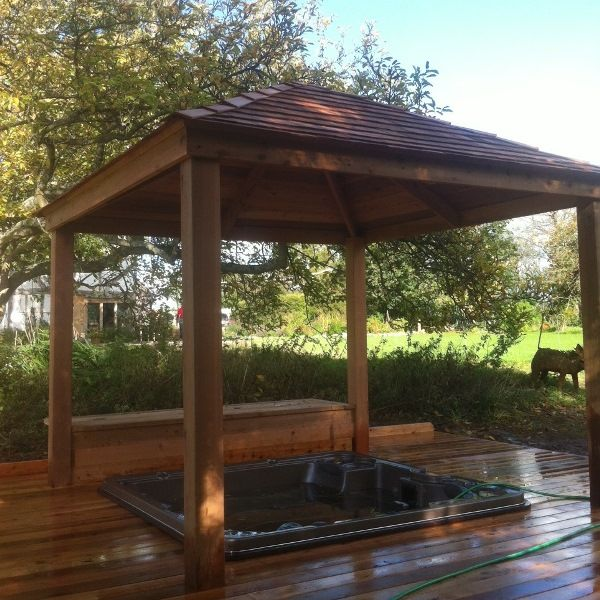 Sunken Hydropool Spa Pool in a cedar deck platform with bespoke cedar pergola over top