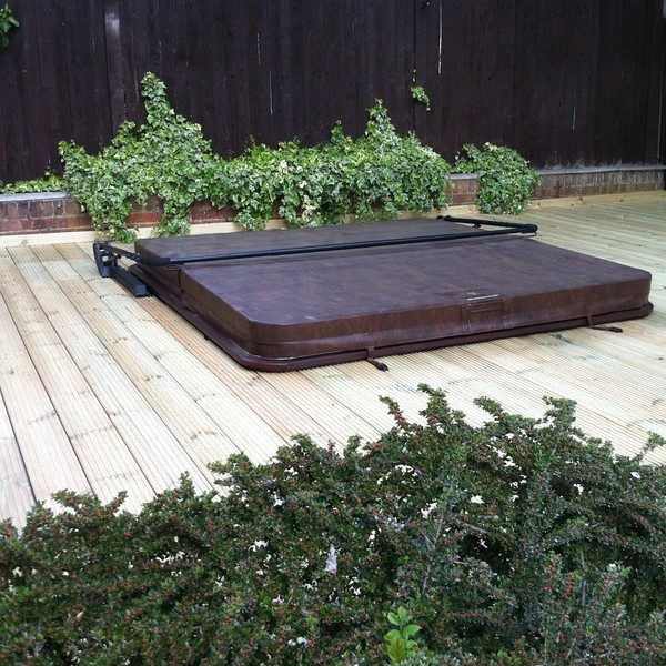 Hot tub sunken in timber decking and surrounded by plants
