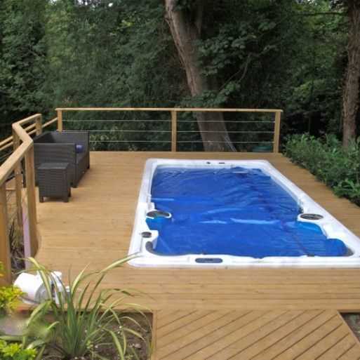 Swim Spa with cover on sunken into a timber decking platform