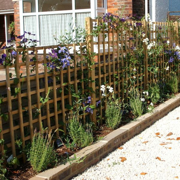 Living wooden trellis fence with planting beds running along