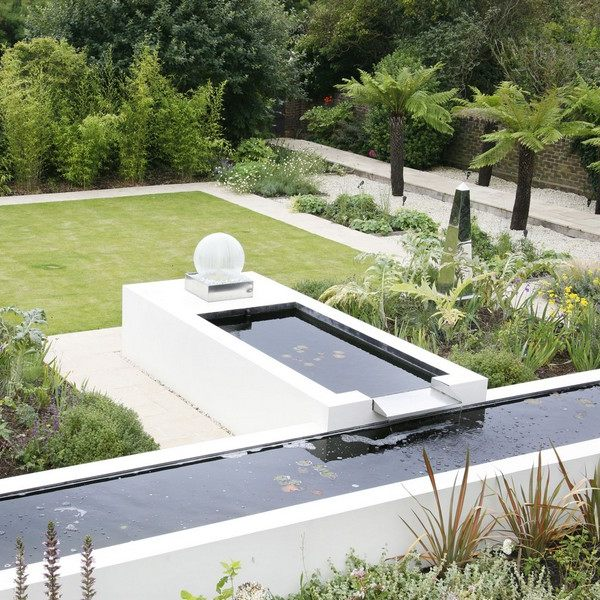 A bespoke water feature design made from a series of white rendered walls