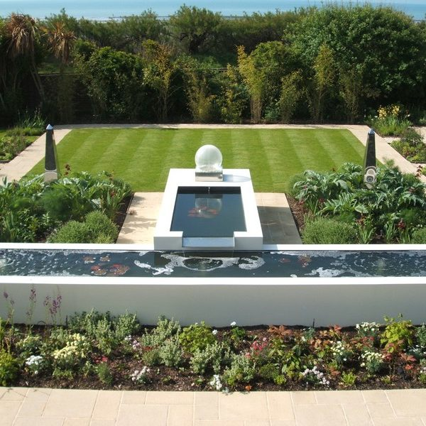 South coast beachfront garden with water feature, garden features and planting